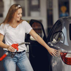 Bad Gas Pump Habits - Woman Refueling Car