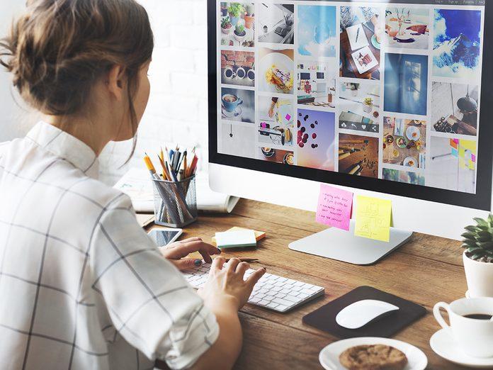 Woman sorting through photos on a computer