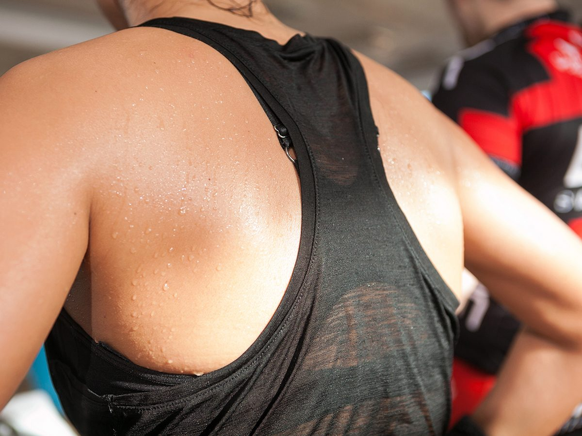 Drinking eight glasses of water a day - woman perspiring
