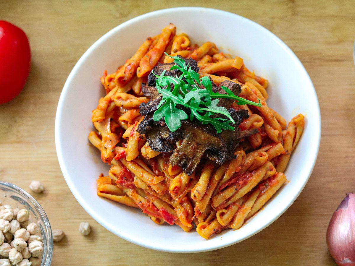 Vegan Chickpea Pasta with Tomato Sauce. Topped with Sautéed Mushrooms & Arugula. Vegan, Gluten Free.