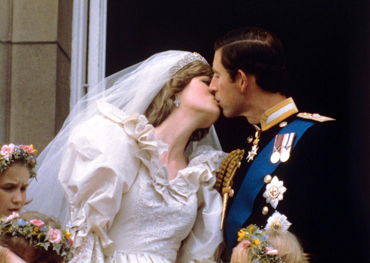 Prince Charles and Princess Diana kiss on the balcony of Buckingham Palace