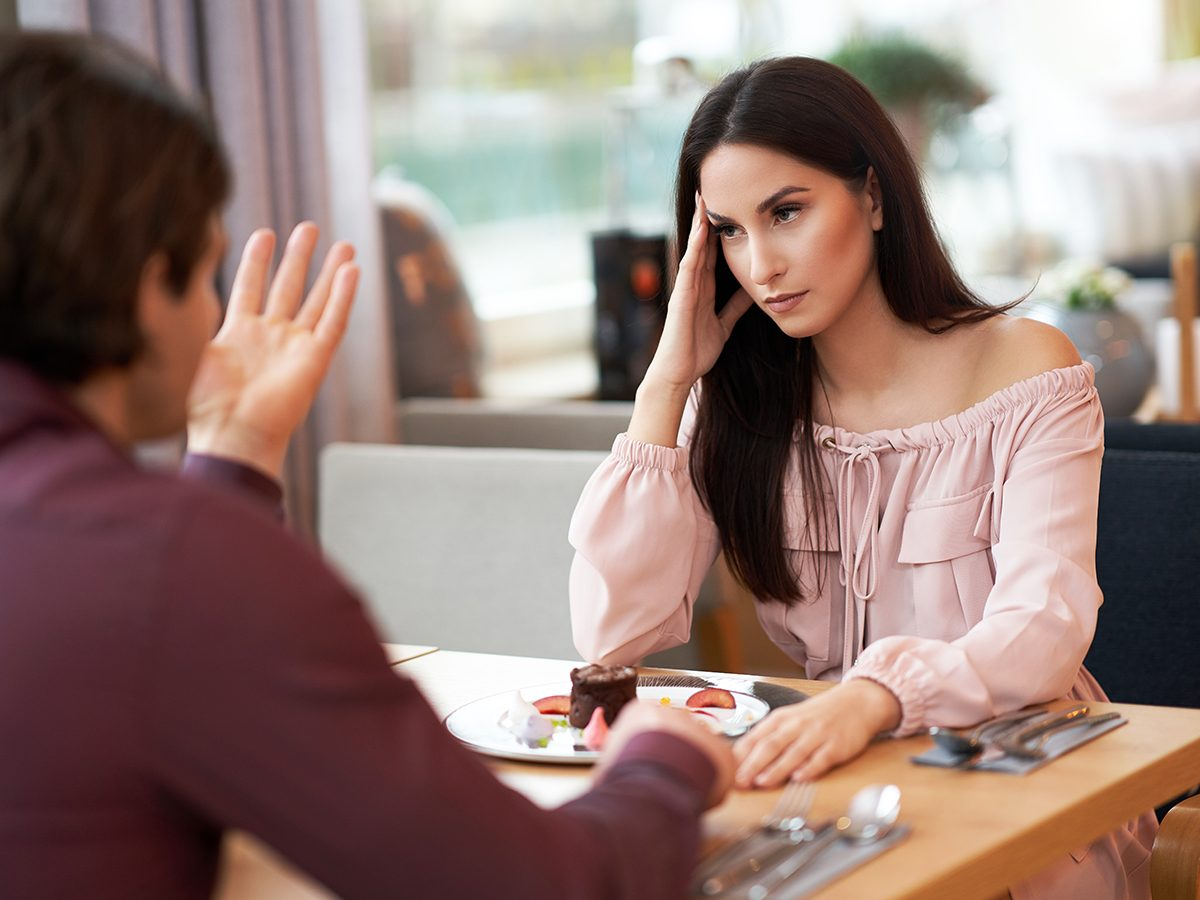 Young Couple having argument In Cafe