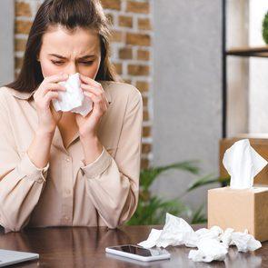 adult onset allergies - Woman Sneezing