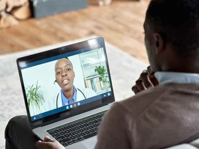 Man using telehealth to speak to doctor