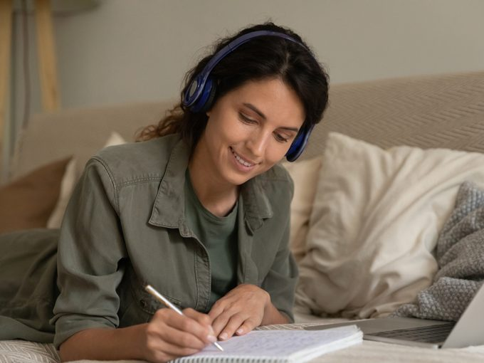 Woman learning a new language at home