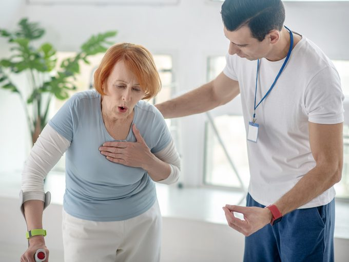 Trelegy Main - Doctor and older patient coughing