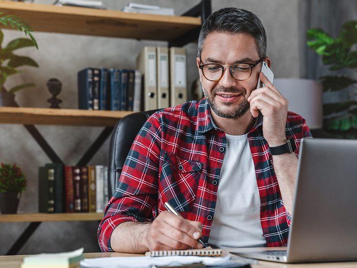 Adult man on phone call - arranging car insurance