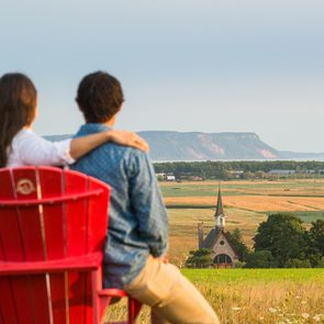 Historical Places Canada - Visitors with red chairs at the Landscape of Grand-Pré View Park. A UNESCO World Heritage Site. Grand-Pré National Historic Site.