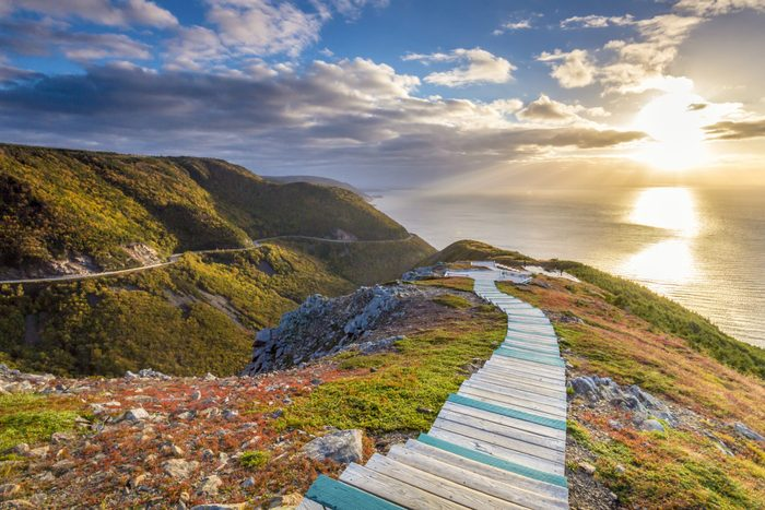 Best place to watch the sunset in every province - A view of the sun setting over the Atlantic ocean from the top of the Skyline Trail in Cape Breton Highlands National Park National Park.