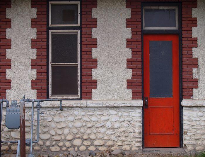 Doors across Canada - Kelowna train station orange door