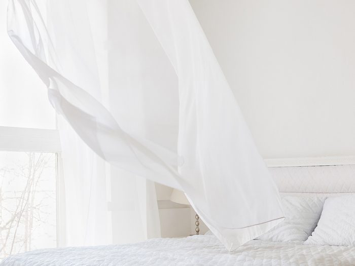 How to cool down a room without ac - blowing white curtain
