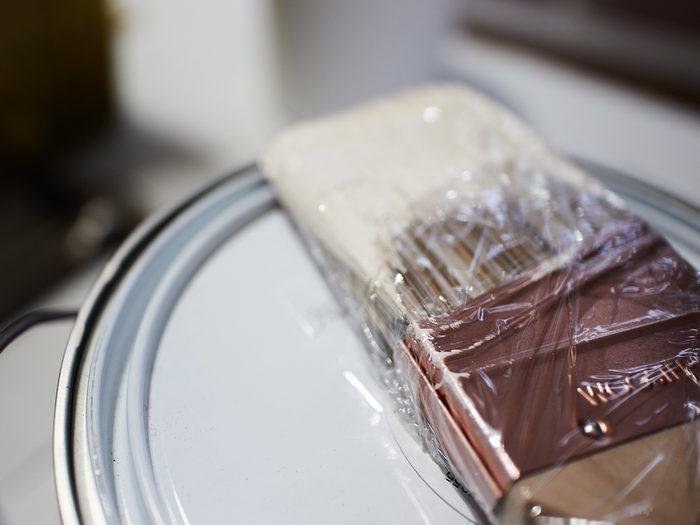 Plastic wrap hacks - paint brush wrapped in plastic