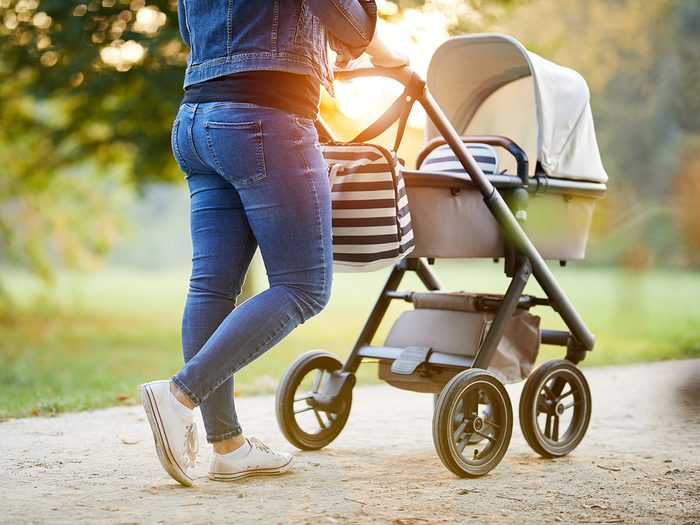 Baby terms - woman pushing stroller in park