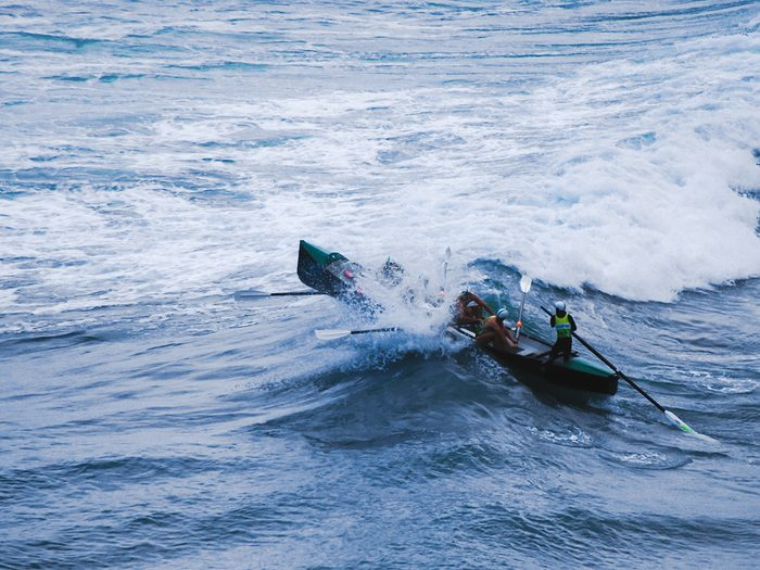 Ocean words - rowing boat into crashing waves